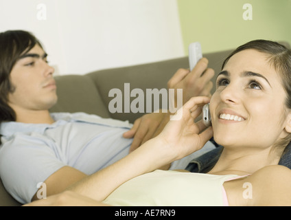 Two friends using cell phones - Stock Photo