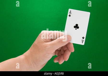 Ace of Clubs in Hand - Stock Photo