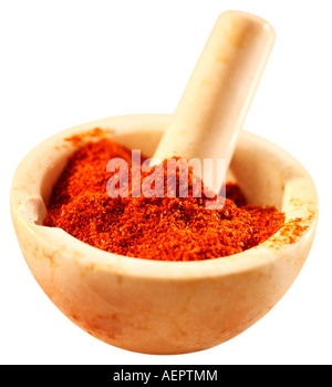 CHILLI POWDER IN PESTLE AND MORTAR CUT OUT - Stock Photo