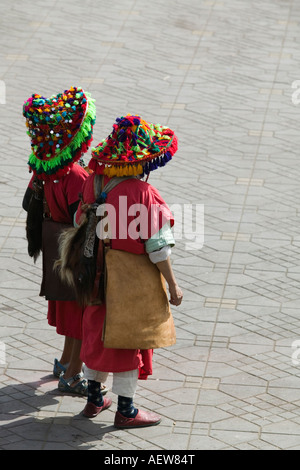 Two Moroccan Water Sellers in Marrakech's Djemaa el Fna Square - Stock Photo