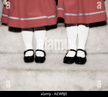 Feet and legs of two girls - Stock Photo