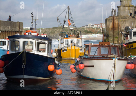 Fishing boats in Newquay Harbor in Cornwall United Kingdom - Stock Photo