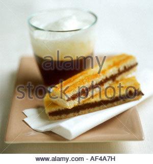 Cinnamon and chocolate slice and espresso macchiato - Stock Photo
