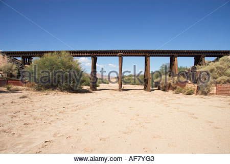 Old Wooden Railroad Trestle Bridge over dry wash in southeastern Arizona - Stock Photo