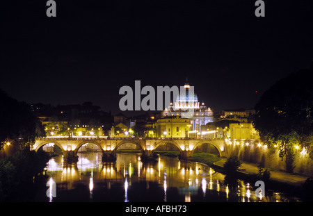A distant view across the Tiber River of the dome of Saint Peter s Basilica in the Vatican Rome - Stock Photo