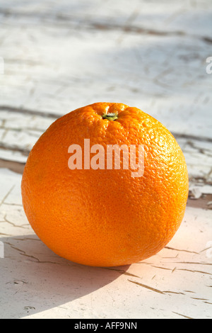 Whole Orange Citrus Fruit on old painted wood background - Stock Photo