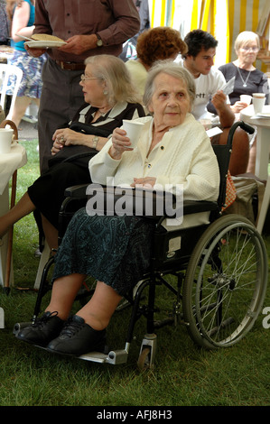 Disabled lady on a wheelchair at the Capital Age Festival 2005, London - Stock Photo