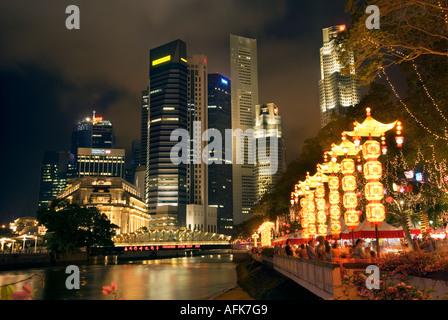 Singapore skyscraper skyline at night citylights Esplanade HarbourFront Fullerton Hotel UOB Plaza Lim Bo Seng Memorialpark - Stock Photo