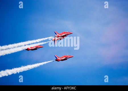 Red Arrows Royal Air Force RAF aerobatic display team in Hawk trainer aircraft at Fairford international airshow - Stock Photo