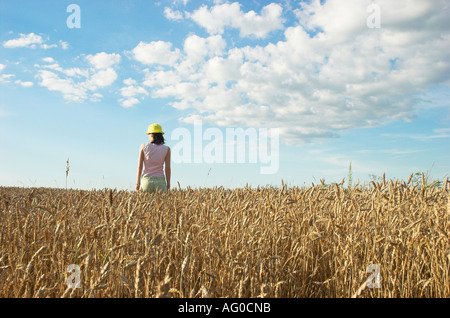 Young woman in wheat field - Stock Photo