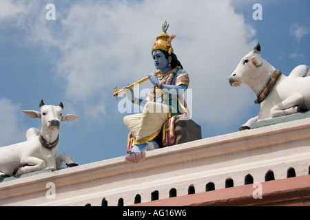 Ornate sculptures of Hindu deity at the Sri Mariamman Hindu Temple in Singapore - Stock Photo