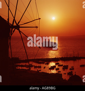 Cruise Ship anchored at sunset Mykonos Harbour Cyclades Greece - Stock Photo