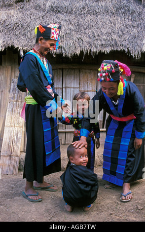 Laos, Luang Prabang, Women and children from Hmong hill tribe - Stock Photo