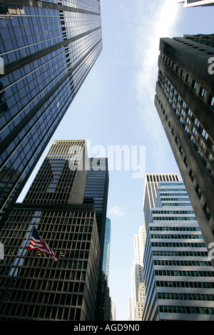 looking up at skyscrapers with stars and stripes flying rockefeller plaza center new york city new york USA - Stock Photo