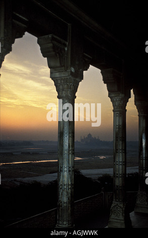 Sunrise over the Yamuna river and the Taj Mahal, taken from the Agra fort. - Stock Photo