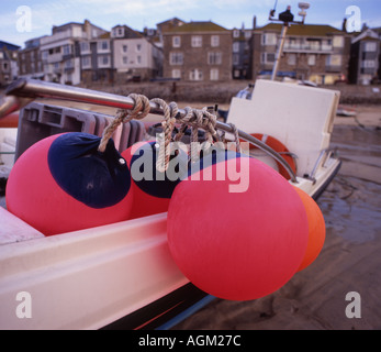 floats and fenders tied to st ives fishing boat cornwall in 7x6 - Stock Photo