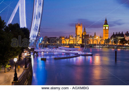 The London Eye and the Houses of Parliament at night, London, England. - Stock Photo