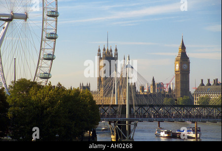 UK London London Eye Hungerford Bridge Houses of Parliament beyond - Stock Photo
