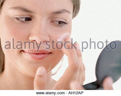 A woman applying make-up - Stock Photo