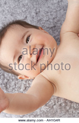 A baby girl laughing - Stock Photo