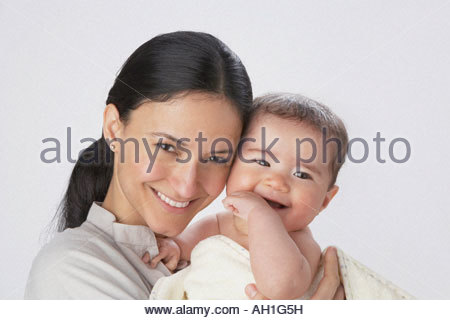 A woman holding a baby - Stock Photo