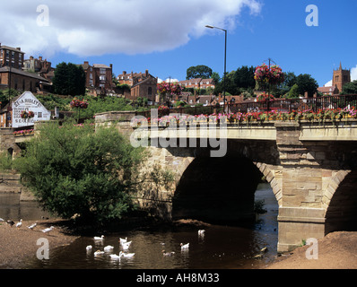 BRIDGNORTH SHROPSHIRE UK August Looking up to High Town from the multi arched English Bridge over the River Severn - Stock Photo