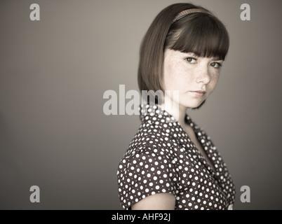Portrait of young girl in studio - Stockfoto