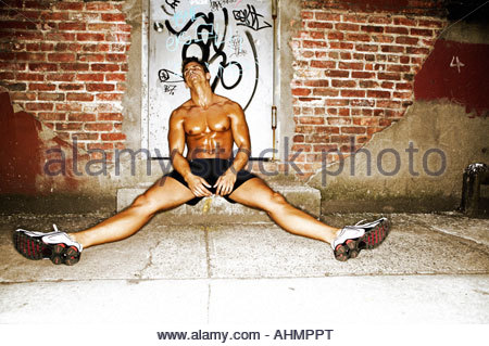 Fitness athlete man relaxing and stretching muscles and ...
