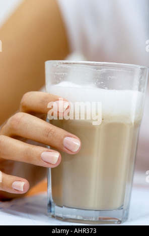 Close-up of hand holding drink - Stock Photo