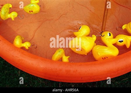 Rubber ducks in paddling pool - Stock Photo