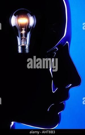 Head with light bulb - Stock Photo