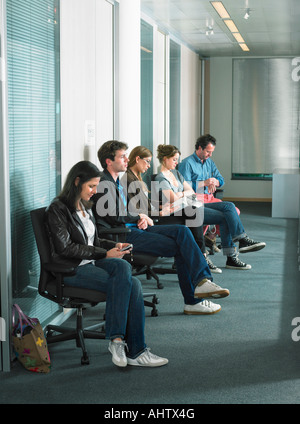 Patients sitting in waiting room of a hospital. - Stock Photo