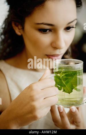 Woman drinking herbal tea. - Stock Photo