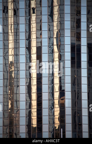 Abstract architectural image of office building reflection detail in evening light Brisbane Queensland QLD Australia - Stock Photo