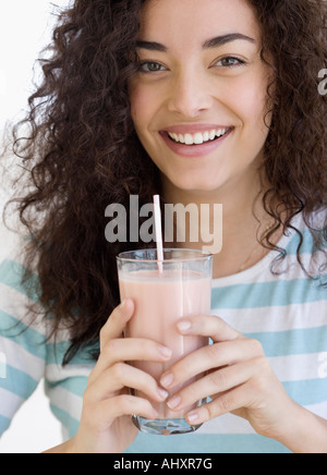 Woman drinking milkshake - Stock Photo