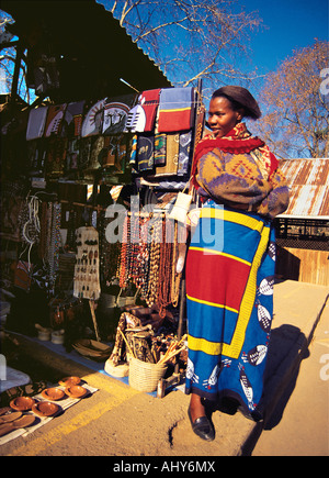 An African woman wearing traditional dress at her stall in Mbabane market Swaziland - Stock Photo