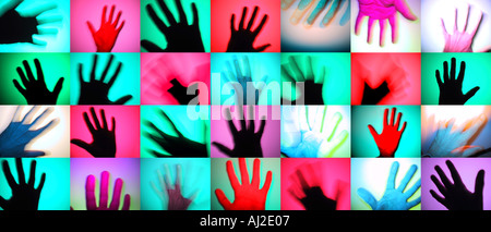 Rows of colourful hands. A modern photographic take on prehistoric rock art. - Stockfoto