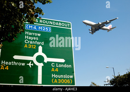 a plane flying low and approaching ariport for landing, UK - Stock Photo