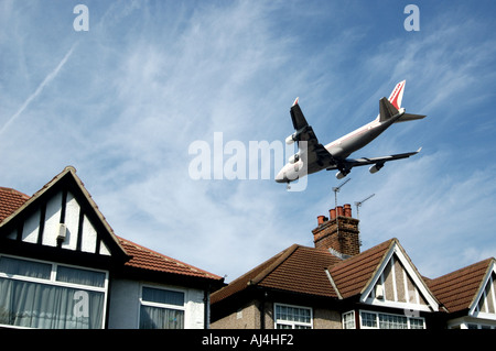 plane flying low and approaching ariport for landing - Stock Photo