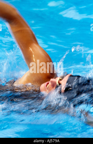 Female freestyle swimmer in motion - Stock Photo