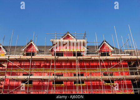 New environmental friendly residential buildings showing the pink cavity insulation material used for the construction. - Stock Photo