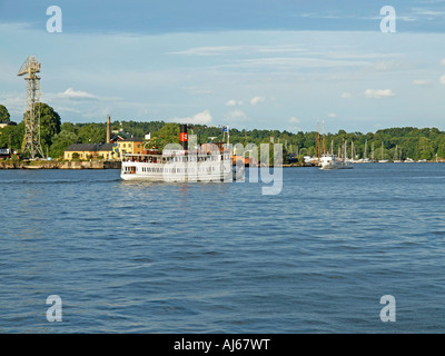 old steam boat in front of the amusement park Skansen on the shore of Baltic Sea in Stockholm in Sweden - Stock Photo