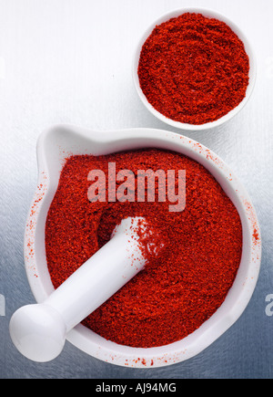 CHILLI POWDER IN PERSTLE AND MORTAR - Stock Photo