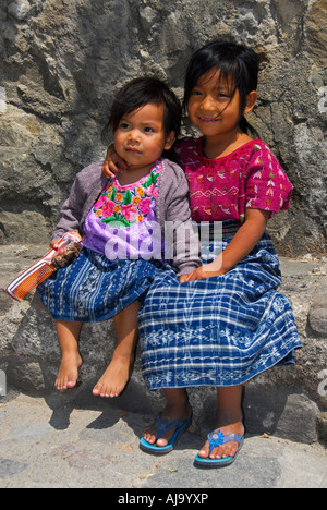 Indigenous girls in traditional Mayan dress - Stock Photo