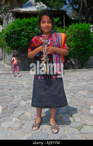 Indigenous girl in traditional Mayan dress - Stock Photo