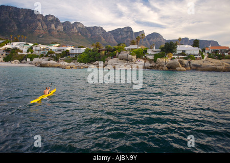 View of a Canoeist Rowing Back to Shore - Stock Photo