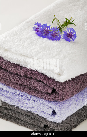 Towels on white background decorated with blue cornflowers Studio shot - Stock Photo