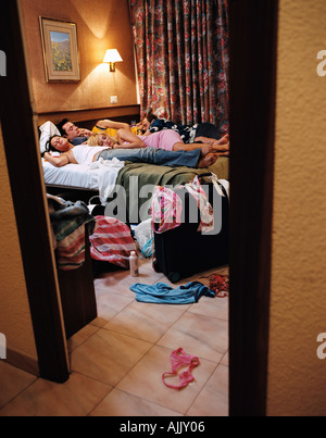 Young people sleeping in hotel - Stock Photo
