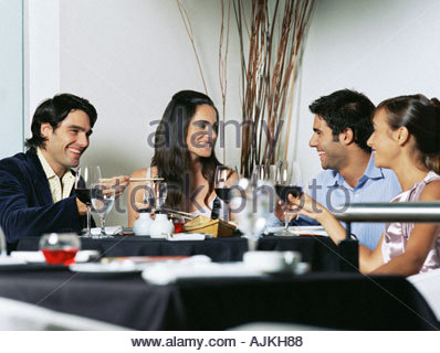 Friends in a restaurant - Stock Photo