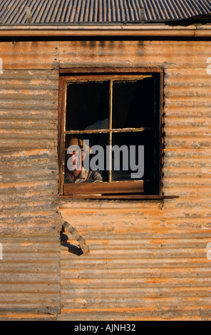 Man at window, Australia - Stockfoto